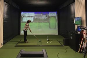 A Female Golf Player practise golf in a visual platform.